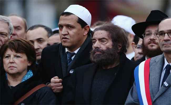 مسيرة مثيرة للجدل ضد الإرهاب يرأسها كاتب يهودي وإمام مسلم