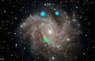 اكتشاف أضواء لامعة غامضة في مجرة بعيدة...