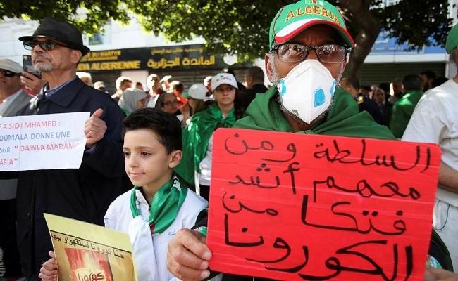الدينار أكثر المتضررين من كورونا والحكومة تدعو الجزائريين إلى ابتعاد عن المظاهرات